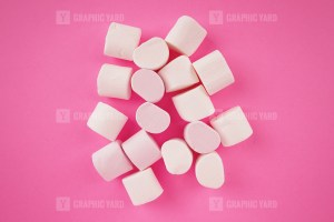Pile of marshmallow on pink background stock image
