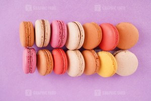 Row of macaroons on purple background stock image