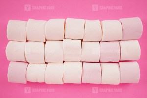Stack of marshmallow on pink background stock image