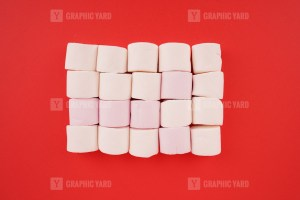 Stack of marshmallow on red background stock image