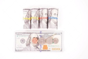 Coins and dollar banknotes isolated