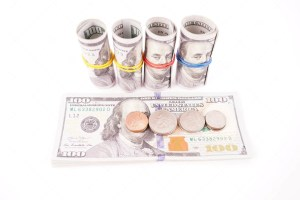 Coins and dollar bills isolated