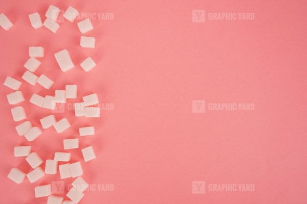 Lump sugar on bright pink stock image