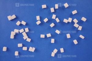 Lump sugar on navy stock photo