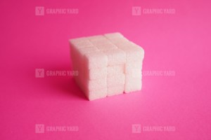 Sugar cube on pink background