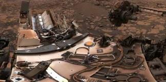 Curiosity surveys a mystery under dusty mars skies