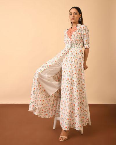 Posing Woman wearing elegantly printed Modern Indian fusion Dress Kurta with Flared Pants
