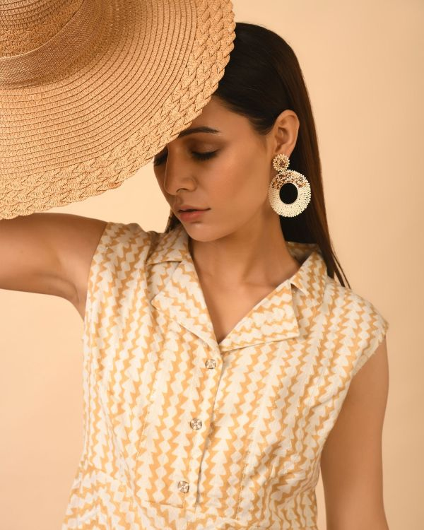 Woman in hat wearing Cotton Printed top