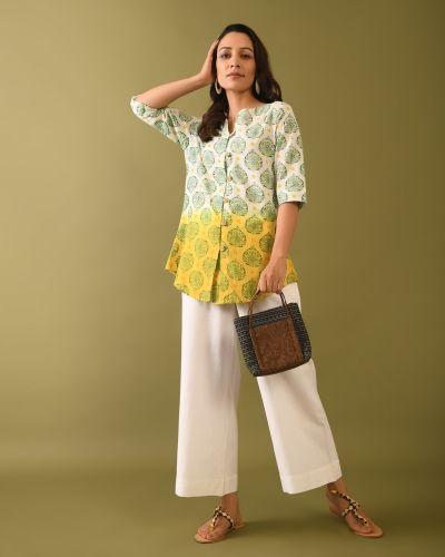 Stylish Woman carrying bag wearing Block Printed tunic with tie dye