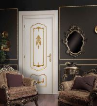 Luxury white door in baroque style in a dark room interior ...