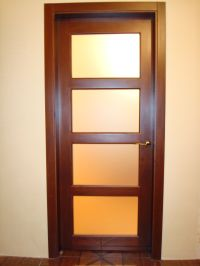 Modern brown wooden door with glass in bright room