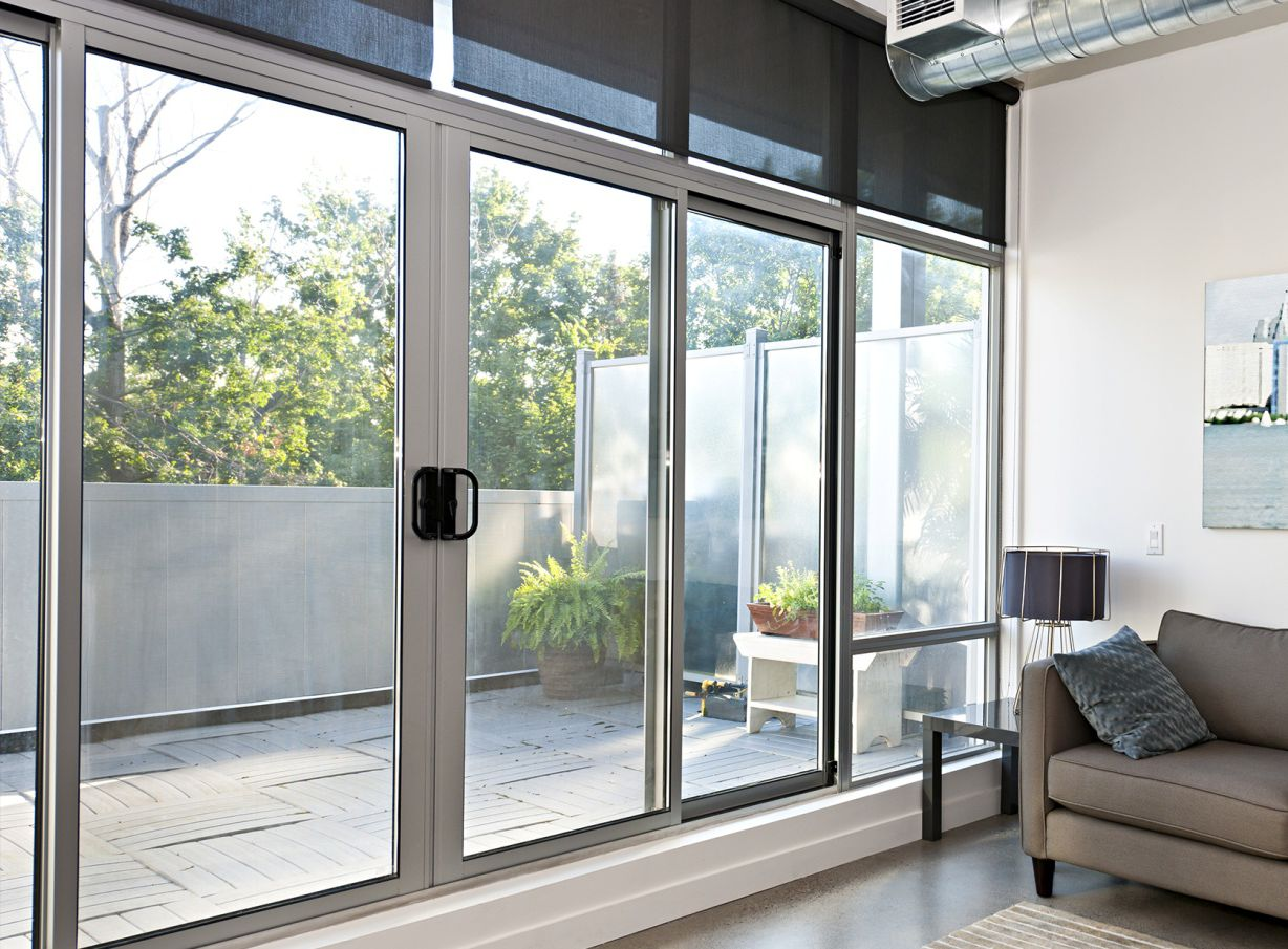 White sliding aluminum door with a large glass for the