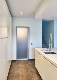Modern interior design kitchen with aluminum door with ...