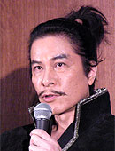 Kaga as Ota Nobunaga; the actor is in costume as the 16th-century warrior, but fielding press questions -- hence the microphone not invented in 1549