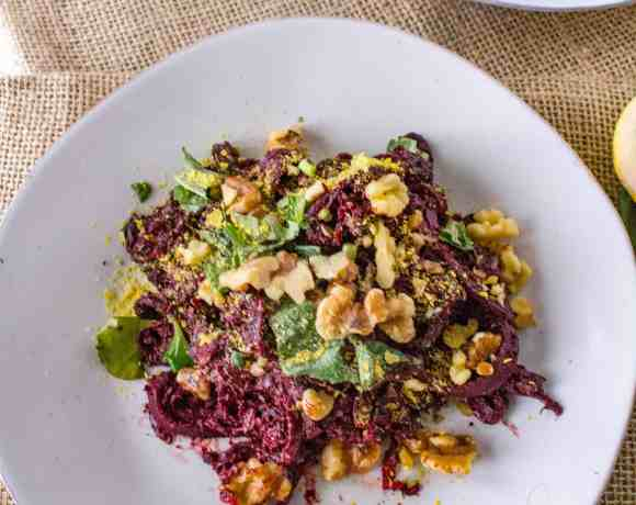 These spiralized beet noodles are served with a homemade pesto sauce using beet greens! A delicious and completely plant-based vegan meal!