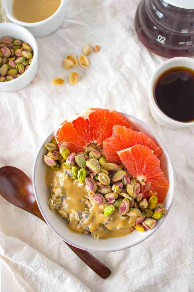 Breakfast Oatmeal Bowl with Grapefruit, Pistachios, + Sweet Tahini Drizzle. A vegan and gluten free healthy breakfast recipe from The Grateful Grazer.