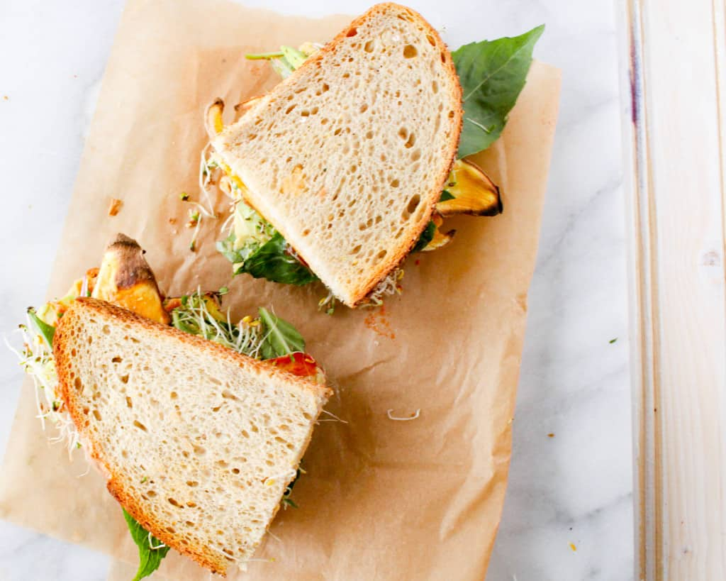 This sweet potato hummus sandwich is a convenient and transportable plant-based lunch that the entire family will love. Vegan, whole grain, and plant-based!