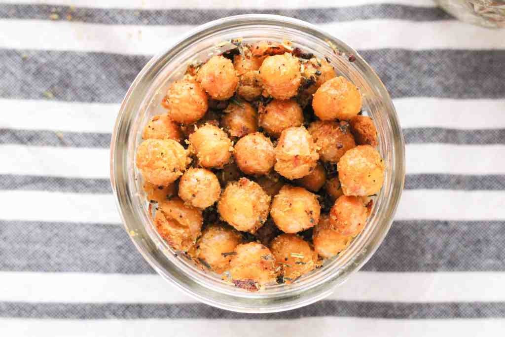 These Cheesy Roasted Chickpeas make a delicious dairy-free snack! Learn how to make cheesy, crunchy, and completely plant-based roasted chickpeas.