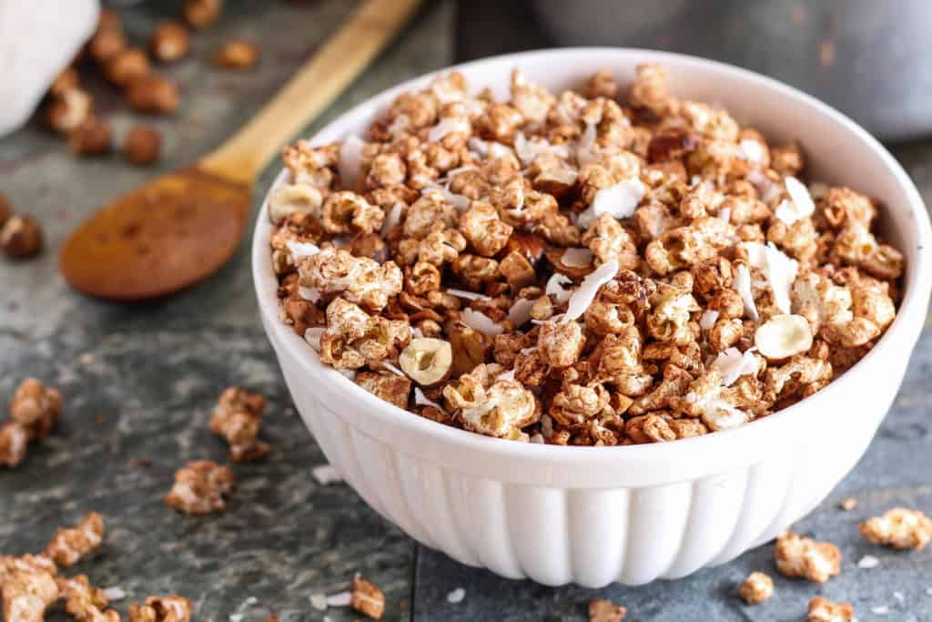 Chocolate popcorn is a delicious way to eat more whole grains! This dessert popcorn recipe is plant-based/vegan, and free of refined sugars and dairy.