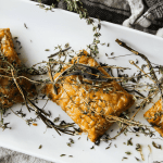 This simple recipe for herb baked tempeh is a flavorful entree that's wholly worthy of a coveted spot on your holiday table.