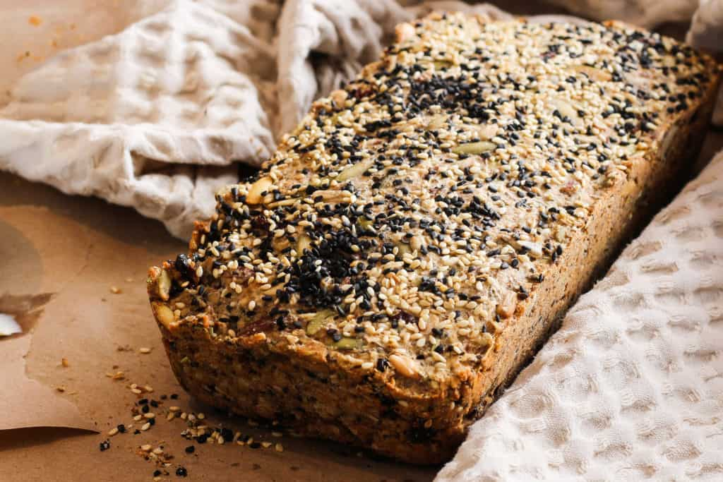This hearty nut and seed bread is flavored with sesame seeds and dried cherries for a healthy and delicious plant-based breakfast or snack.
