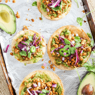 Tempeh tostadas are baked and topped with mashed avocado and soy for a quick healthy meal or snack that is plant-based and vegan with a gluten-free option.