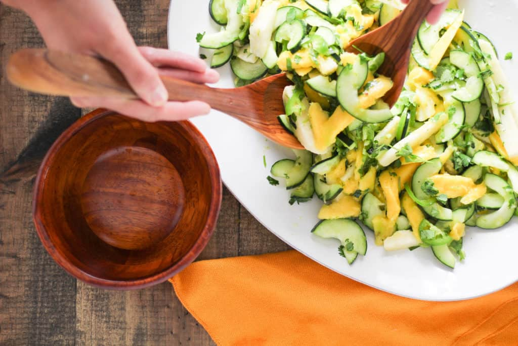 Upgrade your go-to summer fruit salad with a colorful Mango Cucumber Salad with Jicama! Easy vegan/vegetarian and gluten-free recipe!