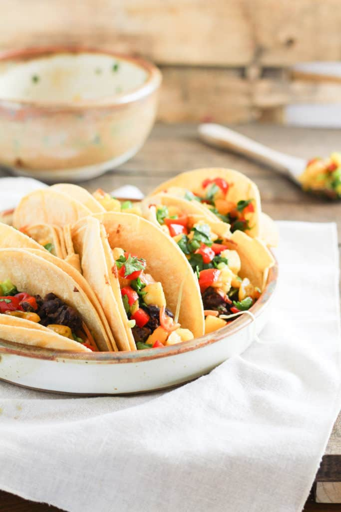 Add a little zest to your summer meals with healthy Black Bean Street Tacos topped with Tropical Fruit Salsa!