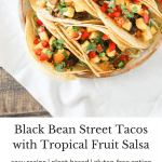 #ad Add a little zest to your summer meals with healthy Black Bean Street Tacos topped with Tropical Fruit Salsa! Vegetarian recipe with gluten-free option.