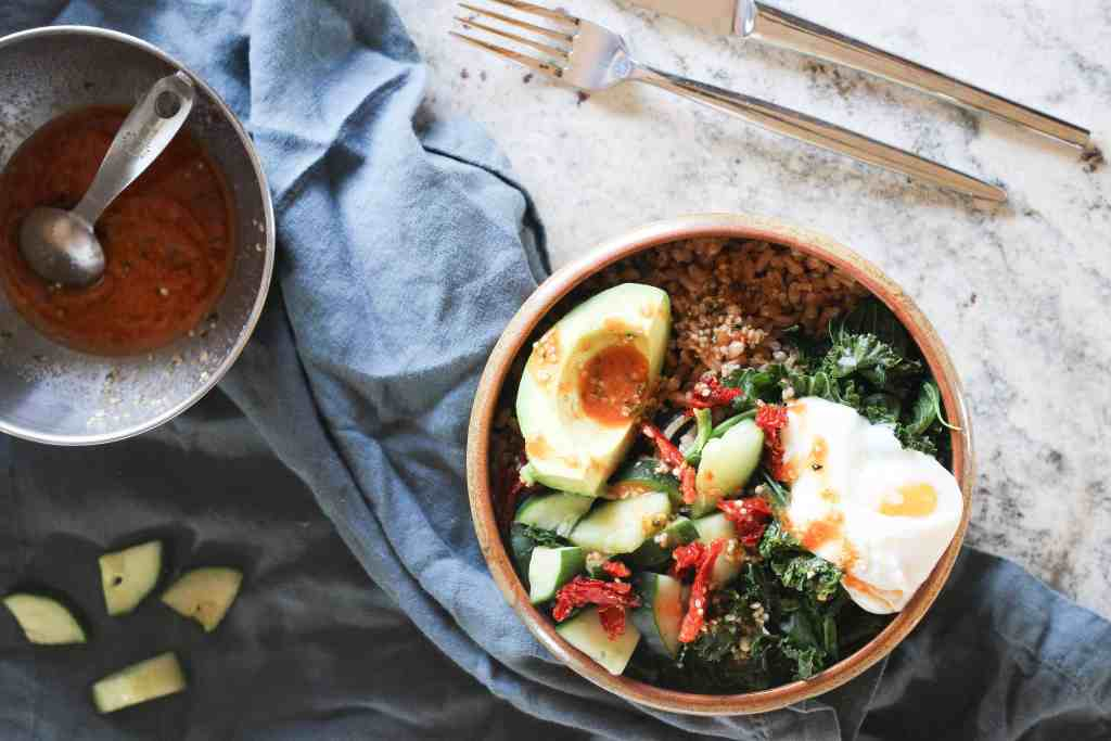 Savory breakfast bowls are a delicious way to use up last night's leftovers while fueling your body for a busy day ahead. Made with farro, kale, eggs, and miso!
