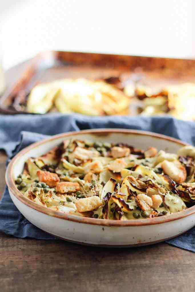 This Vegan Caesar Salad recipe with roasted cabbage is a warm and comforting twist on the supper club classic. It's good enough to eat with your hands!