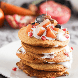Pumpkin Oat Pancakes with Fruit & Yogurt Topping - a delicious breakfast or brunch dish for fall. This plant-based recipe is a crowd-pleaser!