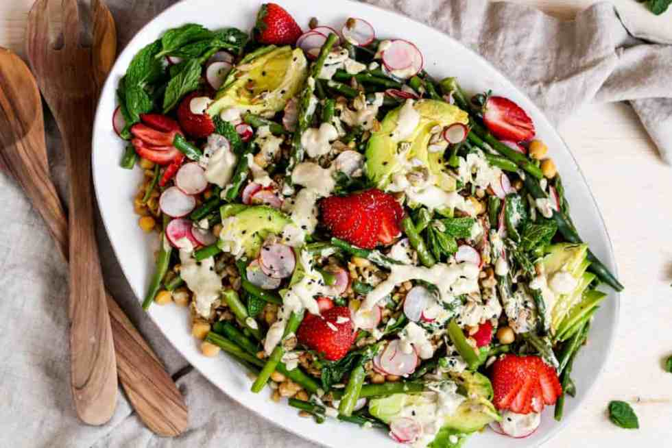 Spring farro salad. Upgrade your regular grain salad with spring vegetables and creamy, lemon tahini dressing.