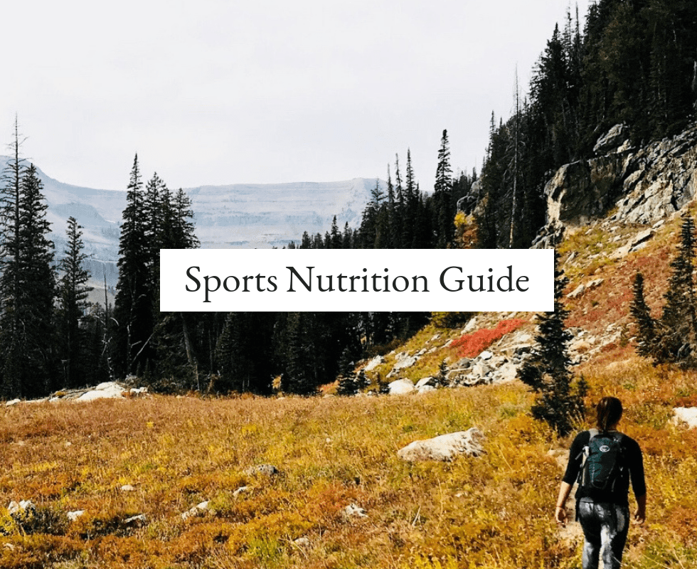 """Girl hiking in autumn with text that reads, """"sports nutrition guide."""""""