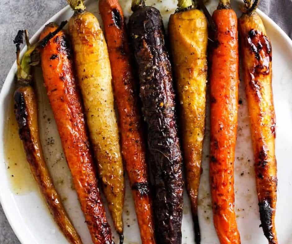 horizontal image of roasted rainbow carrots