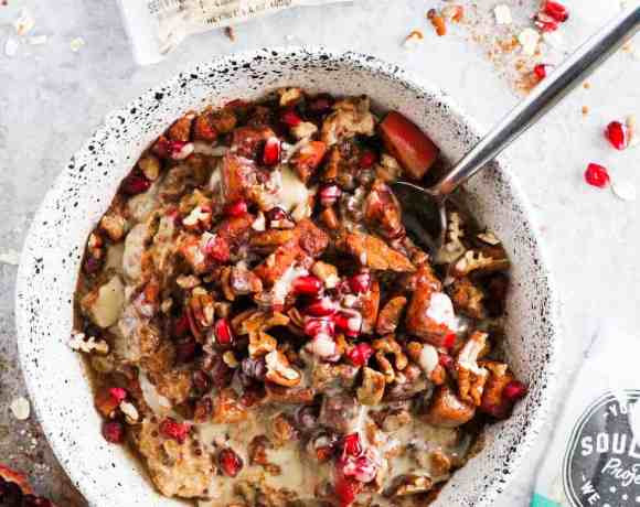Cinnamon apple tahini oatmeal bowl with packets of The Soulfull Project cereals.
