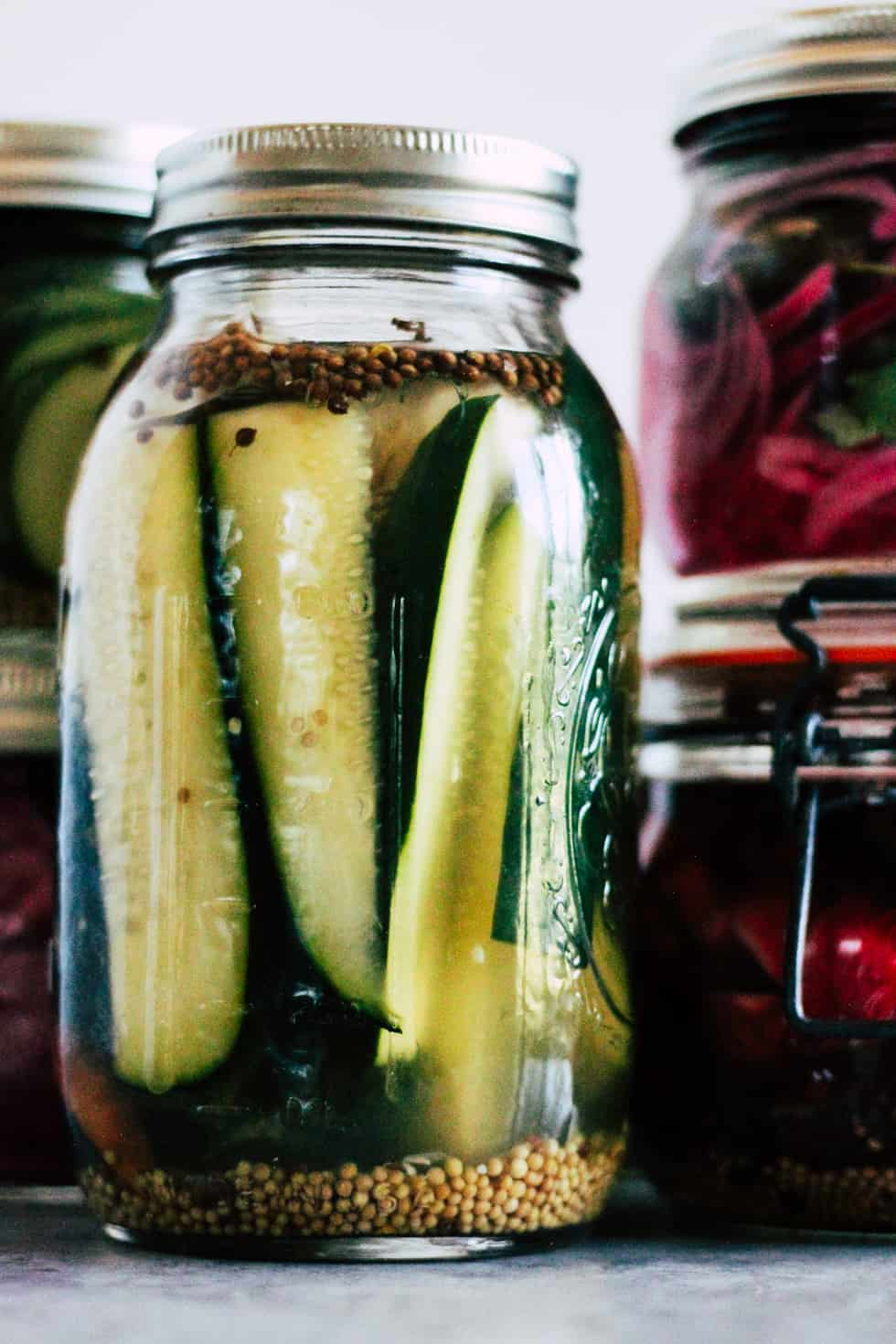 Mason jar filled with pickle spears.