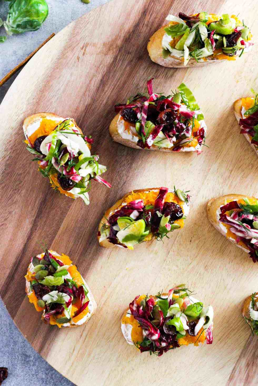 Fall produce mini toasts with squash and brussels sprouts.
