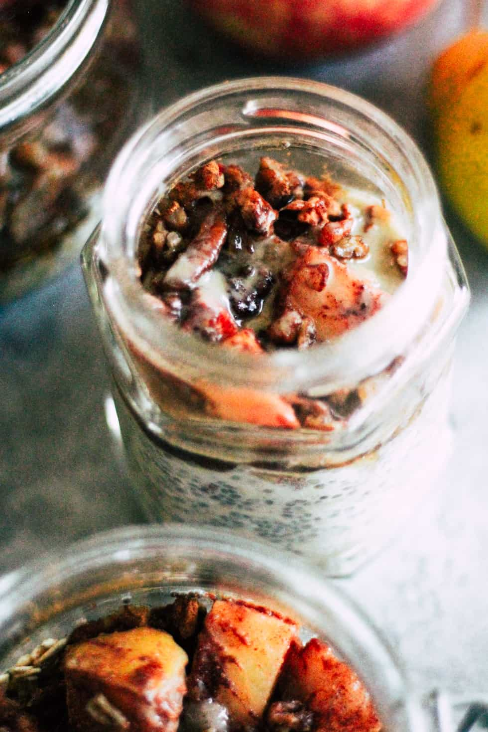 Jars filled with fruit and nuts.