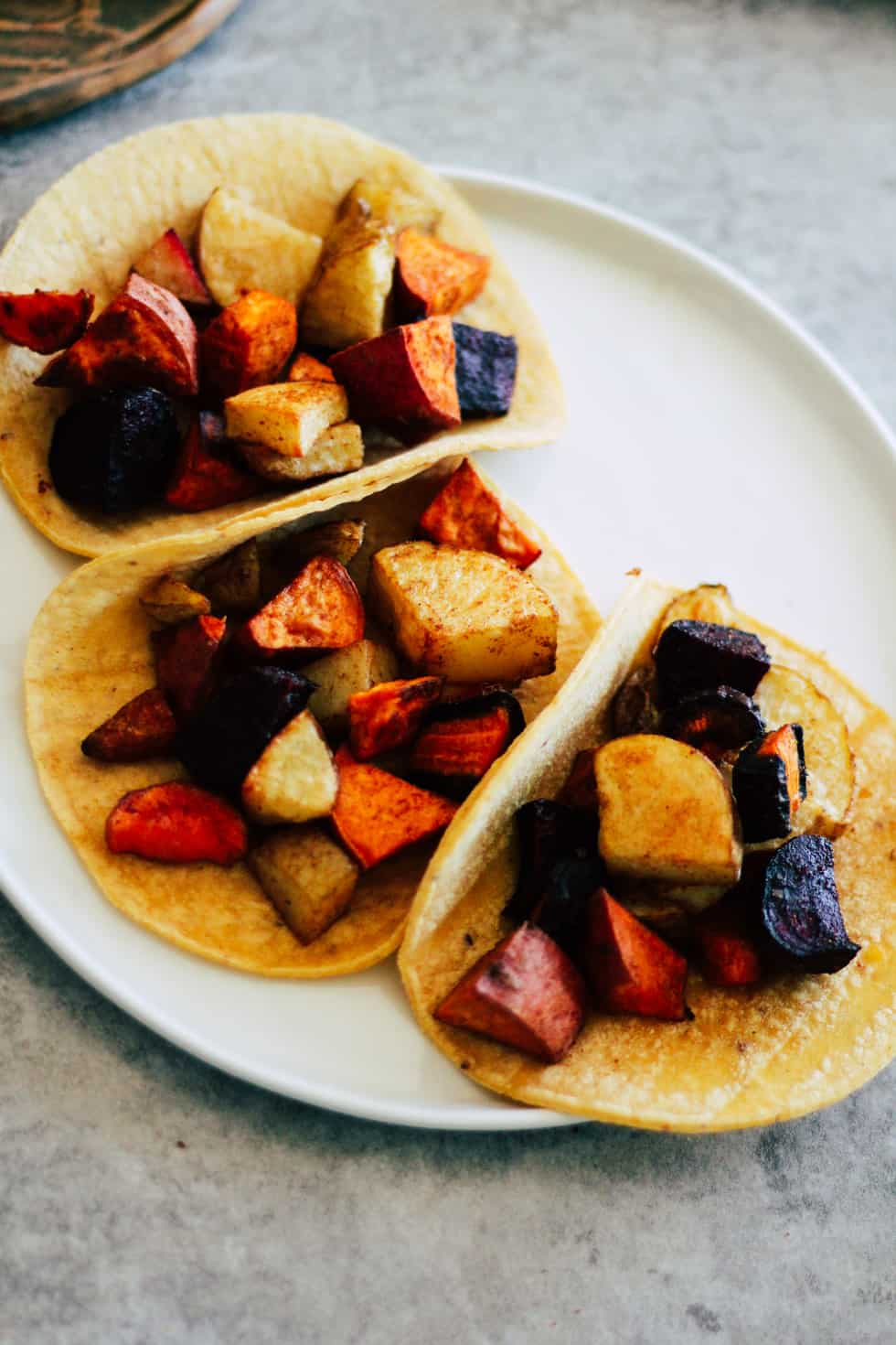 Roasted root vegetables on corn tortillas.