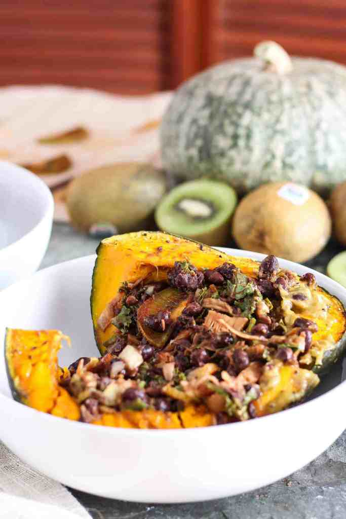 Use Thanksgiving leftovers to make stuffed kabocha squash in a white bowl with jackfruit.