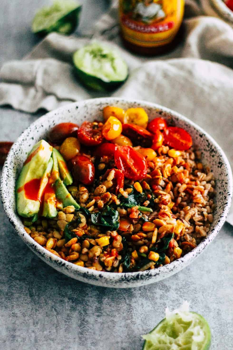 Vegetarian Tempeh Burrito Bowls in a ceramic bowl with linen napkin.