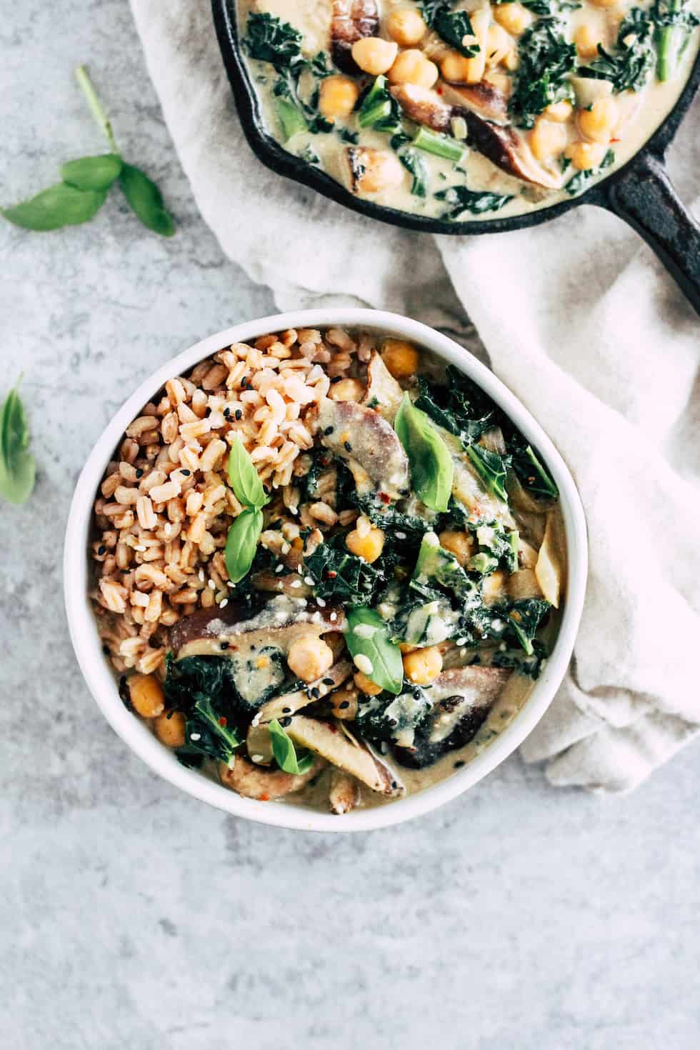 Creamy Vegan Miso Bowls with cast iron skillet and grey background.
