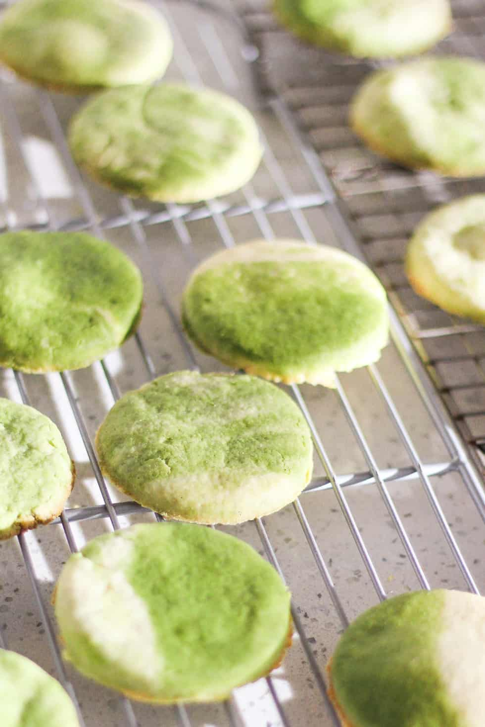 Marbled Matcha Sugar Cookies cooling on white countertop.