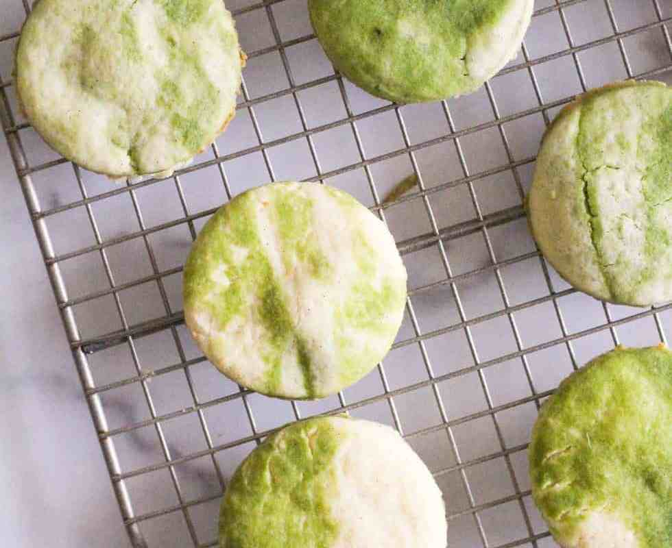 Marbled matcha sugar cookies on wire rack.