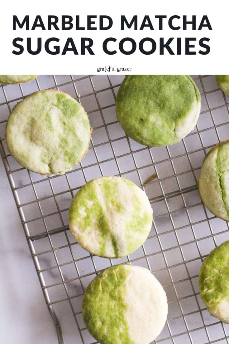 """Green and white cookies on wire rack with text that reads, """"marbled matcha sugar cookies."""""""