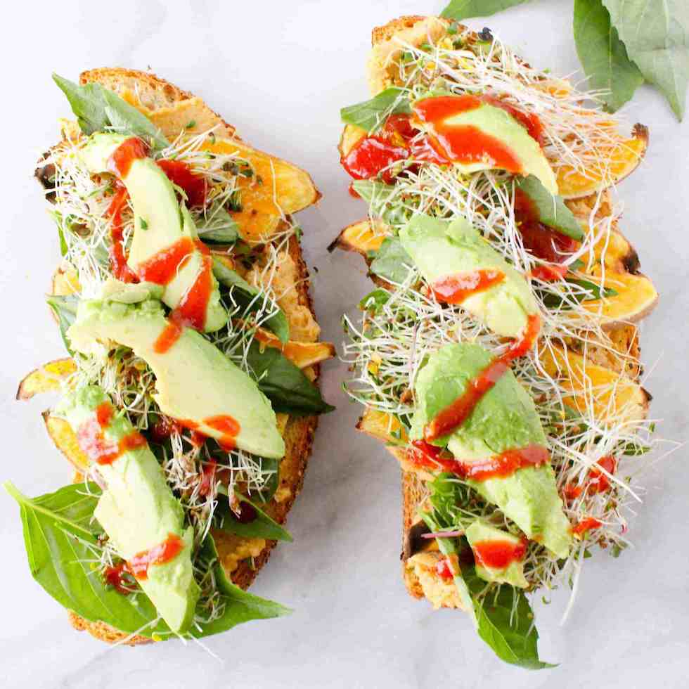 Open face vegetable sandwich as an example of vegetarian lunches to pack for work or school.