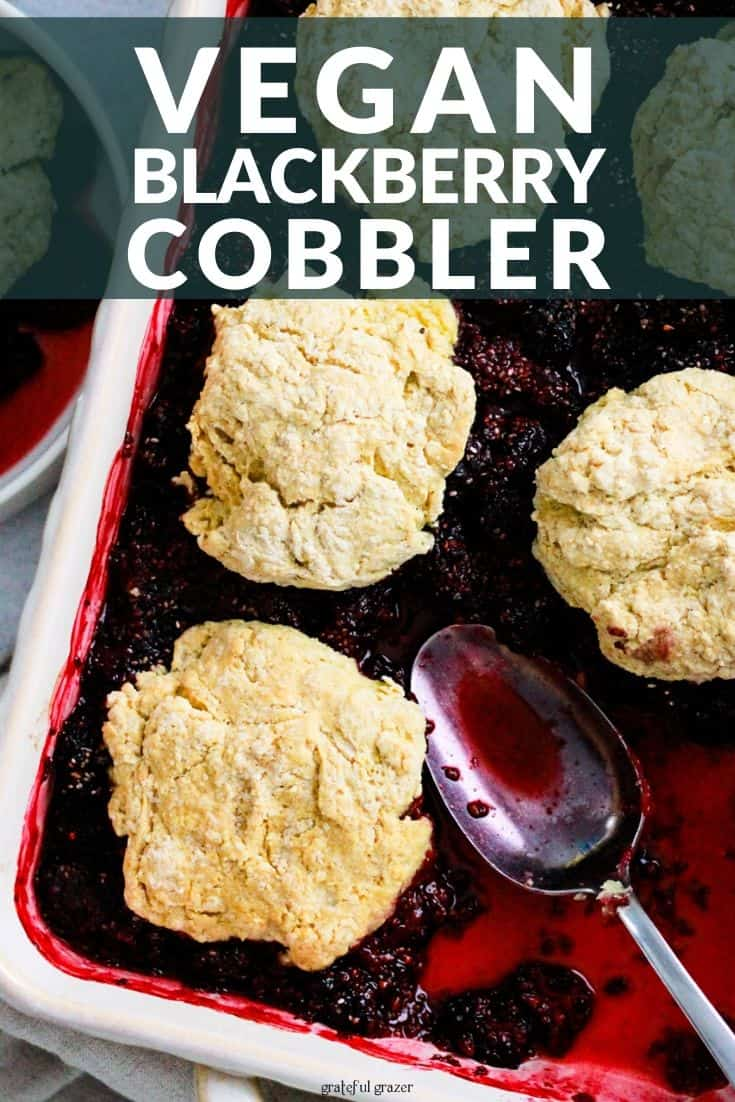 """Berry cobbler in white baking dish with text that reads, """"Vegan Blackberry Cobbler."""""""