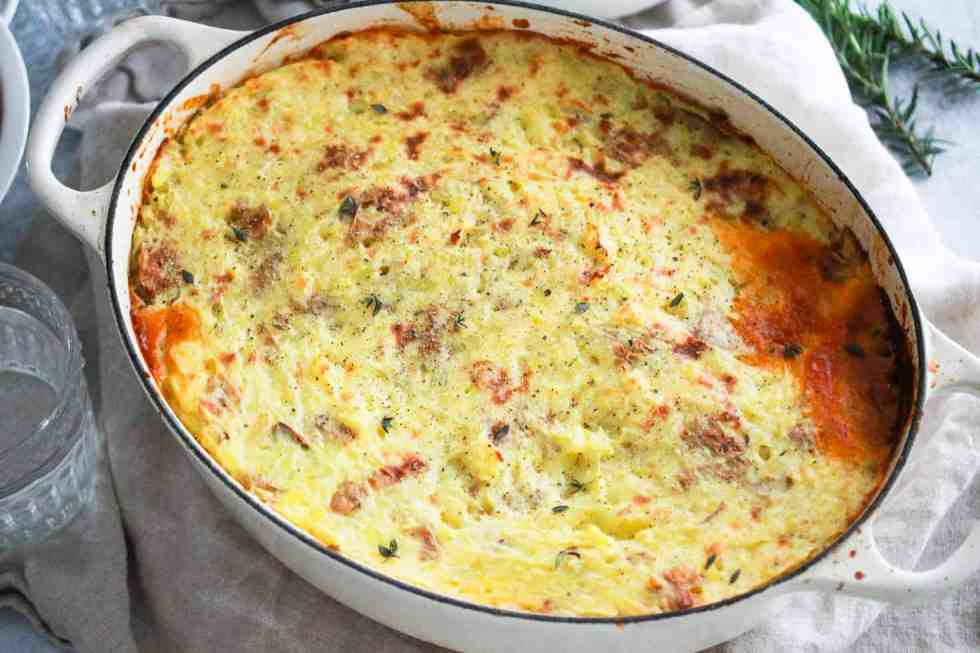 Horizontal image of tempeh shepherd's pie in a dutch oven.