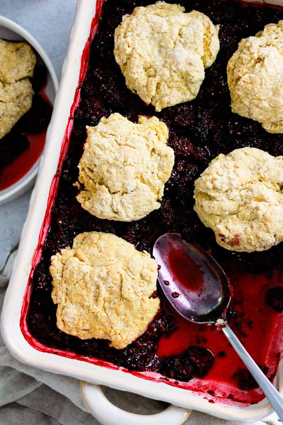 Vegan Blackberry Cobbler in a white baking dish.
